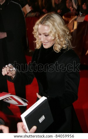 """BERLIN - FEBRUARY 13: Madonna attends the """"Filth and Wisdom"""" premiere at the 58th Berlinale Film Festival at the Zoo Palast on February 13, 2008 in Berlin, Germany. - stock photo"""
