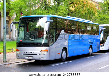 BERLIN, GERMANY - AUGUST 16, 2014: Grey and blue interurban coach Setra S415GT-HD at the city street.