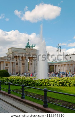 BERLIN, GERMANY - AUGUST 26: The Brandenburg Gate on August 26, 2012. The Brandenburg Gate is the famous landmark of Berlin and Germany located near Pariser Platz. - stock photo