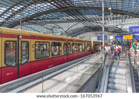 Berlin, Germany - July 25: Unknown Commuters Are Traveling By Train At The Central Station Of Berlin On July 25, 2013 In The Central Station Of Berlin, Germany
