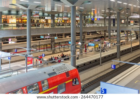 BERLIN, GERMANY - JULY 22: Unknown commuters traveling by train at the central station of Berlin on July 22, 2013 in the central station of Berlin, Germany