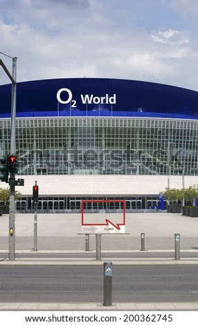 BERLIN, GERMANY - JUNE 16: A traffic light intersection and the square in front of the O2 World building on June 16, 2014 in Berlin / O2 World Berlin