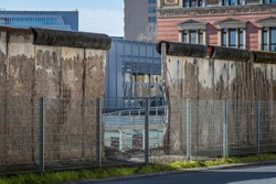 Berlin, Germany - March, 2020 : Berlin wall remains, once this wall cut off West Berlin from surrounding East Germany, including East Berlin