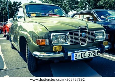 BERLIN, GERMANY - MAY 17, 2014: Compact car Saab 96. Toning. Imitation cross-process. 27th Oldtimer Day Berlin - Brandenburg