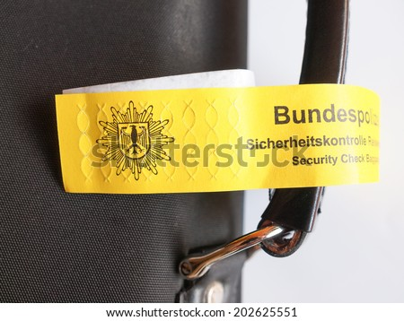 BERLIN, GERMANY - MAY 27, 2014: Police baggage security check at German airport check in