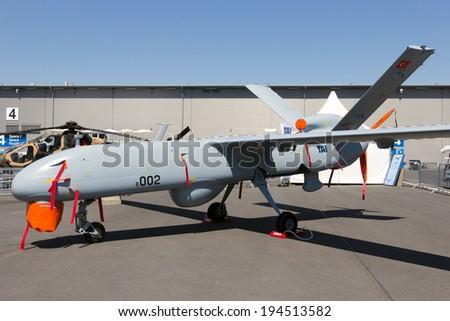 BERLIN, GERMANY - MAY 21: TAI Anka UAV developed by Turkish Aerospace Industries on display at the International Aerospace Exhibition ILA on May 21st, 2014 in Berlin, Germany.