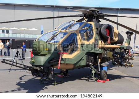 BERLIN, GERMANY - MAY 21: Turkish Aerospace Industries T129 Attack helicopter at the Int. Aerospace Exhibition ILA on May 21st, 2014 in Berlin, Germany. The helicopter is based on the Agusta A129.