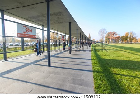 BERLIN, GERMANY - NOVEMBER 2: Passengers walking to Berlin airport on November 2, 2011 in Berlin, Germany. This passage way from the train station protects passengers from rain and wind.