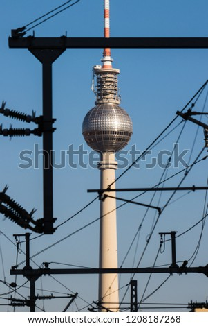 Berlin, Germany, October 7, 2018: view of the TV tower in Berlin. In the foreground are various metal elements of the railway station. #1208187268