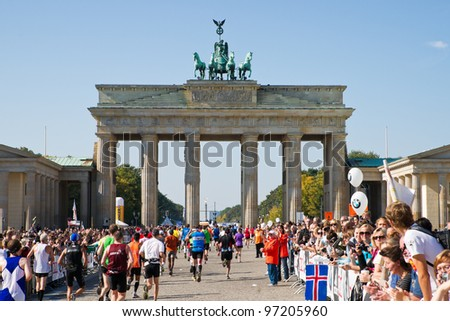 BERLIN, GERMANY - SEPTEMBER 25: Participants of the Berlin Marathon finishing at the Brandenburg Gate on Sept. 25, 2011 in Berlin, Germany.