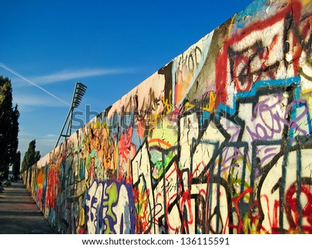 BERLIN, GERMANY - SEPTEMBER 19: Ruins of Berlin Wall (in German, Berliner Mauer) on September 19, 2010 in Berlin, Germany. Fall of the Berlin Wall, November 9/10, 1989. - stock photo