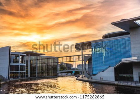 Berlin,Germany:06.10.2018: VIew of Berlin government district on Spree river passing famous Reichstag building and Paul Lobe Haus on at sunset, Berlin Mitte, Germany #1175262865