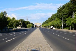 Berlin, Germany, view over the Strasse des 17. Juni to the world famous Brandenburg Gate and the TV Tower at Alexanderplatz in the background