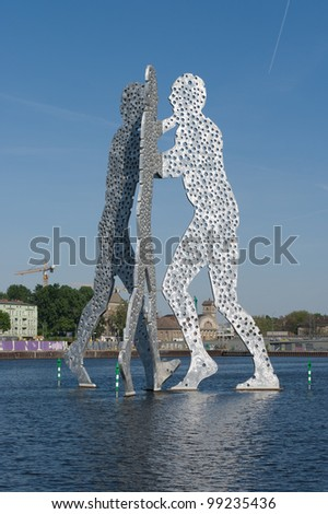 BERLIN - MAY 09: Molecule Man designed by Jonathan Borofsky, on May 9, 2011 in Berlin, Germany. Symbol of the unity of the three restructured in the 2001 district Kreuzberg, Treptow and Friedrichshain