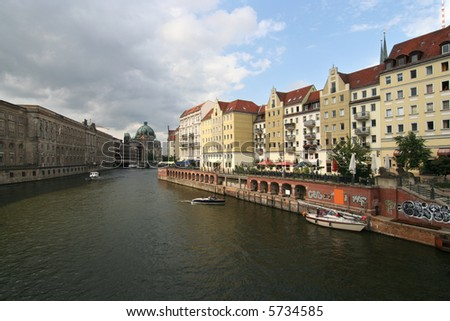 Berlin. Nikolaiviertel with Spree river, with Berliner Dom in the background