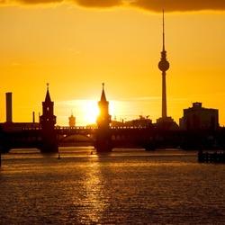 berlin oberbaumbruecke bridge with passing subway train at sunset
