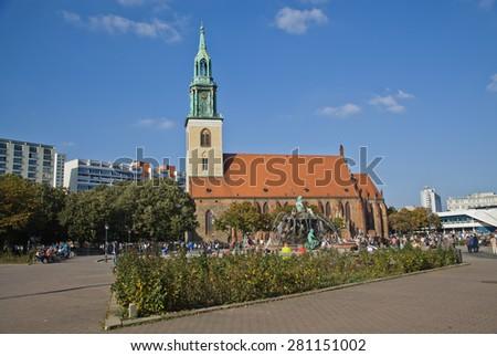 BERLIN,OKTOBER 02:2014 Tourist visit St. Mary Church, known in German as the Marienkirche, located in central Berlin, near Alexanderplatz in Oktober,2014