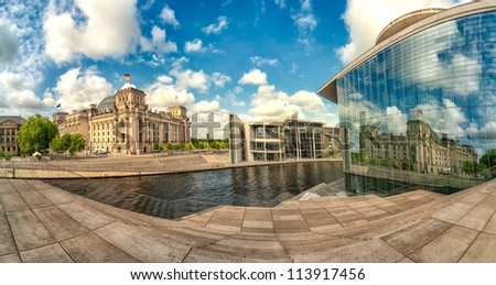 Berlin, old and modern Bundestag buildings on Spree river, Germany