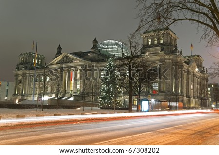 berlin reichstag building in winter with christmas tree