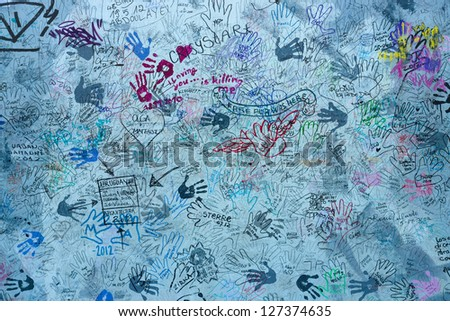 - stock-photo-berlin-september-east-side-gallery-touch-the-wall-by-christine-kuehn-september-in-127374635