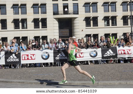 BERLIN - SEPTEMBER 25: Fifth runner of the thirty-eighth Berlin Marathon, Scott overall ,shortly before the finish line on September 25,  2011 in Berlin, Germany.