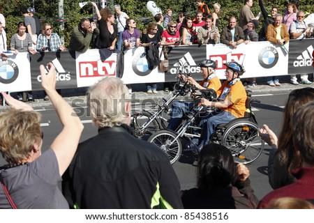 BERLIN - SEPTEMBER 25: Thirty-eighth Berlin  Marathon handbiker mass start on September 25,  2011 in Berlin, Germany.