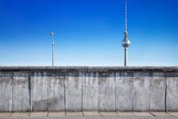 berlin wall against a blue sky