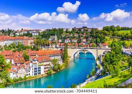 Bern, Switzerland. View of the old city center and Nydeggbrucke bridge over river Aare. #704449411