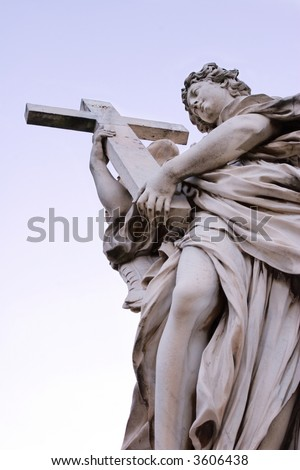 Bernini's Angel on St, Angel's bridge holding a cross - stock photo