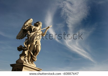 Bernini's marble statue of angel against the background of sky on Sant'Angelo Bridge in Rome