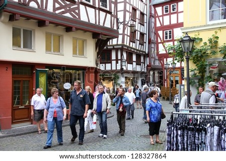 BERNKASTEL, GERMANY - JULY 19: Tourists stroll on July 19, 2011 in Bernkastel-Kues, Germany. According to its Tourism Office, the town is annually visited by 1.5m tourists. Region is famous for wines.