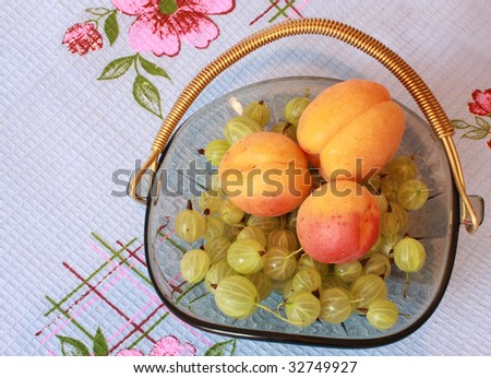 Berries and apricots in the dish - stock photo