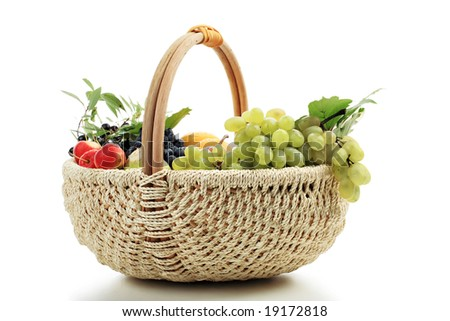 Berries and wine composition in a basket.