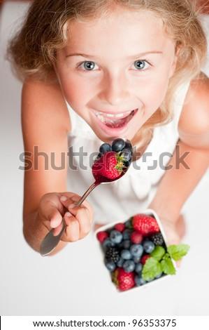 Berries  - Lovely girl eating fresh berries
