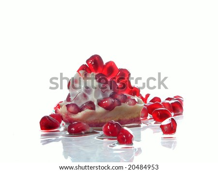 Berries of the broken pomegranate on glass