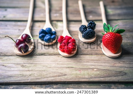 Berries on wooden rustic background #247301389