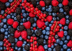 Berries overhead Background. Fresh Summer Berry mix with Strawberry, Raspberry, Red currant,  Blueberry and Blackberry, top view