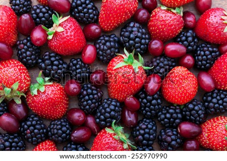 Berries, summer fruit on wooden table. Healthy lifestyle concept, Top view horizontal, Selective focus