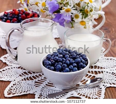 Berry and milk - stock photo