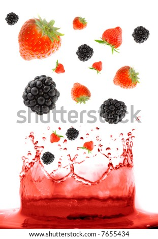 berry falling in juice. Isolation.