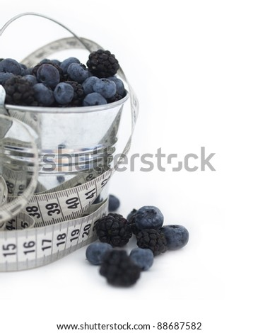 berry fruit with measuring tape, diet concept