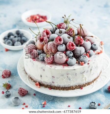 berry ice cream cake served with frozen berries , selective focus