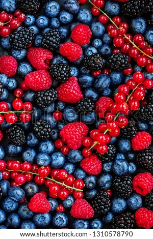 Berry Pattern. Fresh Summer Berries mix Background with Strawberry, Raspberry, Red currant,  Blueberry and Blackberry, top view #1310578790