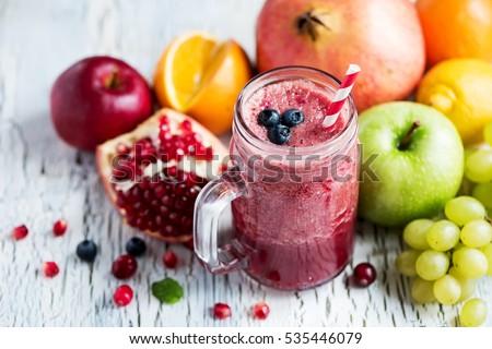 Berry smoothie, healthy juicy vitamin drink diet or vegan food concept, fresh vitamins, homemade refreshing fruit beverage #535446079