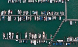 Berth with boats and yachts at sea. Marina bay. Top aerial view. Malaysia