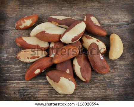 Bertholletia.Brazil nuts on wooden texture