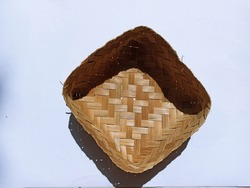 Besek from woven bamboo insulated against a white background.