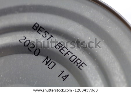 best before date on canned food, close up.