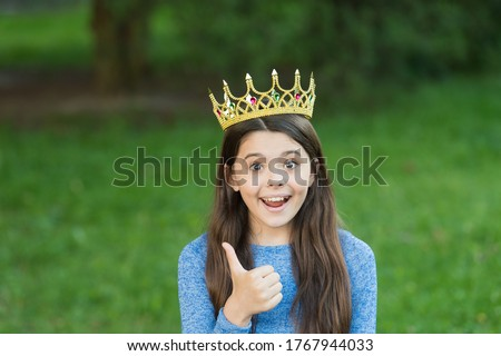 Best boss ever. Happy child in crown give thumbs up. Little boss on green grass. Beauty queen. Prom party. Big boss concept. Glory and triumph. Luxury fashion accessory. Act like lady think like boss.