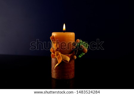 Best Burning Candle Stock Photo on dark background, party calibration concept